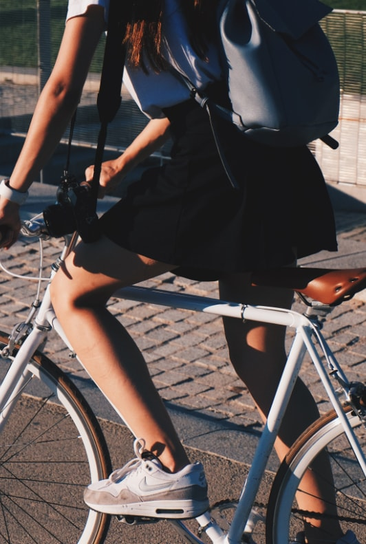 Woman on bike with Nike sneaker